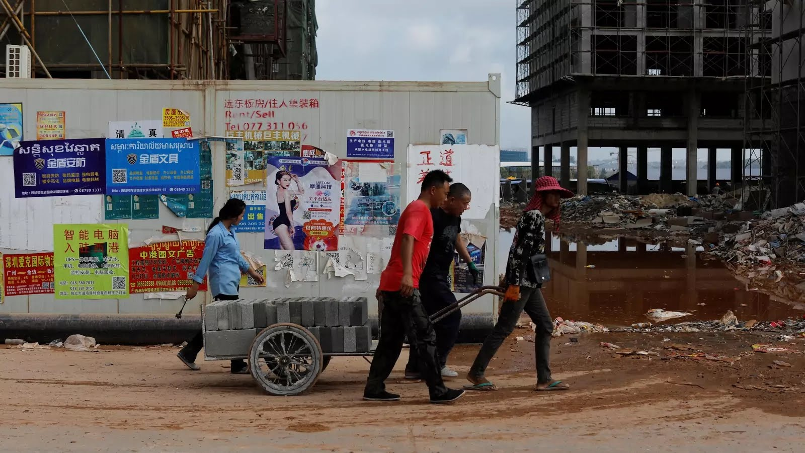 Construction workers move cement blocks in Chinatown, Sihanoukville, Cambodia, on May 18, 2019.